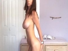 Brunette hottie with big natural boobs dances on camera