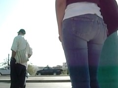 A brunette girl showing her tight ass in jeans