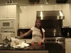 Brunette sucks and doggystyle fucks her bf in the kitchen