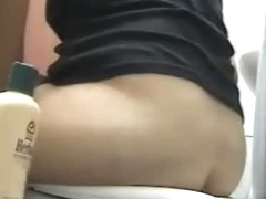 Plump bottomed chck filmed pissing with a toilet spy cam