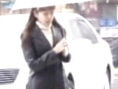 Rainy street sharking scene of some truly glamorous Japanese chick