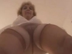 Busty old slut masturbates in stockings