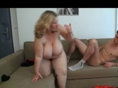 Golden-Haired big beautiful woman is expecting for the youthful Car-Mechanic