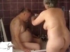Busty granny washes her chubby husband whiled being completely naked