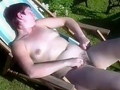 gratifying my wife with a sex-toy whilst that babe is tanning