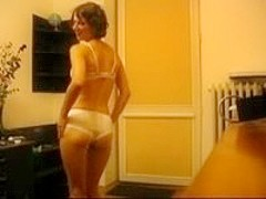 Hot mature wife stripping in bedroom