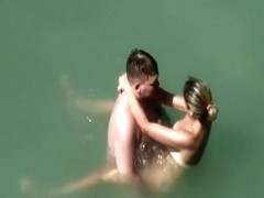 Adorable woman has steaming hot sex in the water