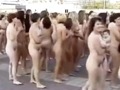Hundreds of people strip nude to pose for a picture