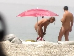 Chubby girl undresses at the beach