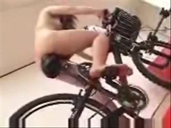 Asian girl tests out the dildo bicycle