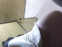 Asian women in public toilet peeing