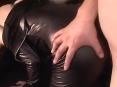 Hot redhead in a sexy costume enjoys oral sex