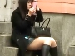 Spying a sexy asian girl fixing her makeup