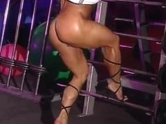 bodybuilder aged in training center with high heels
