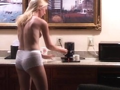 Candid girl topless cooking