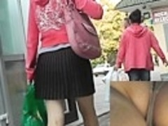 Gal in pleated petticoat hurries up for bus