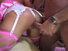 British golden-haired receives drilled clothed in pink fishnets