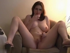 Creamy redhead plays with herself