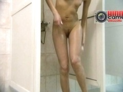 Perfect asses in the shower caught on a voyeur spy cam