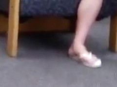college girl in flip flops at the library
