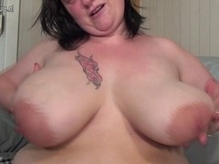 Large breasted aged big beautiful woman playing with her toy