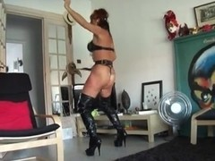Masked beauty in leather whips herself hard