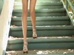 My sex-hungry brunette GF plays with a vibrator on the stairway