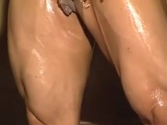 A female bodybuilder showing her large clitoris in the sauna.