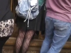 Upskirt of pretty young tart in fishnet tights