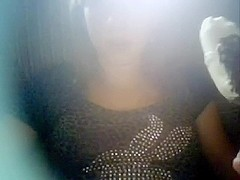 Shy young black brown eats ice-cream and flashes her scones on webcam
