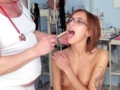 Skinny girlie Jane wears glasses in gyno exam room