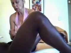 Massage girl gives an erotic massage to her black client