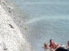 Nudist couple fucking in the water and shore