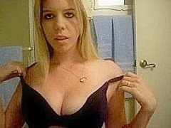 Horny sexy blonde w/ big tits strips