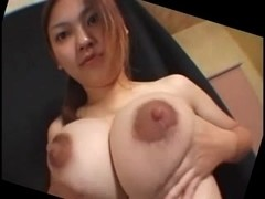 Busty Japanese MILF amateur teases with her jugs