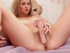 Vicious cutie deeply fondles cunt with dildo before the