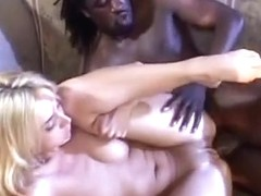 Nasty blonde Kelly Wells has a black rod drilling her twat and her ass