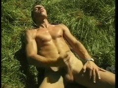Fella massaging rod in the forest