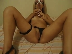 Masked blonde gets wild with a dildo