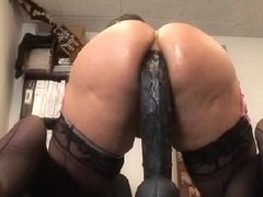Kelly drills her globes with a huge dildo in sex video