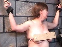 Overweight woman receives her love muffins nailed in wood in dungeon play with mature dom