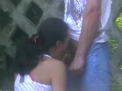 Voyeur tapes a ponytailed brunette giving her bf a blowjob in public