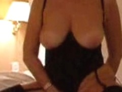 Mature dame in sexy black lingerie played with her shaved twat