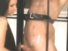 Femdom Tugjob By Tristan Behind Bars & Fastened