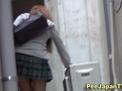 Asian babes piss outdoors and leave puddle