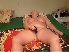Mature lady masturbates with toy while husband tapes it