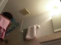 Sexy black girl caught nude in her own bathroom by a spy cam