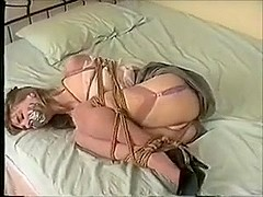 Kristine Tightly Ball-Tied on the Bed