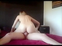 Flat blonde riding a dick