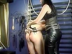 Cute mistress jerks tied guy's cock in a dungeon